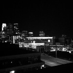 Black and white picture of the Minneapolis skyline at night.
