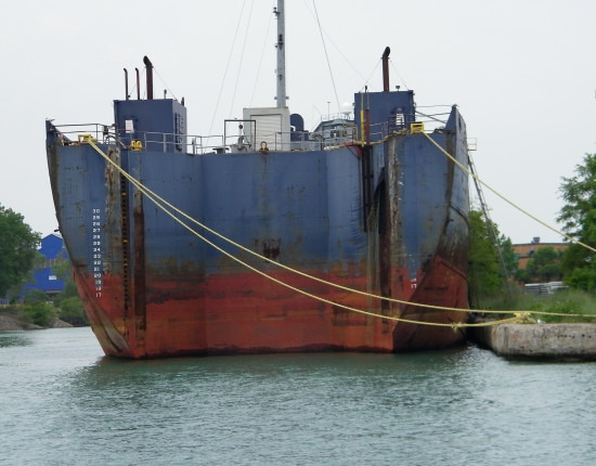 A large boat is tethered to land in Detroit, Michigan.