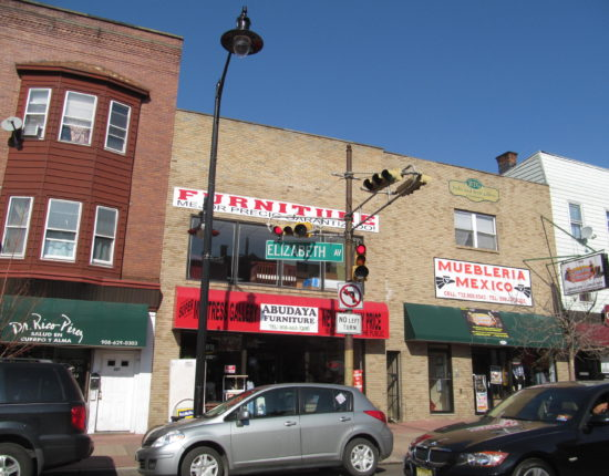 Three cars are parked on Elizabeth Avenue in Mexico in front of a furniture store.
