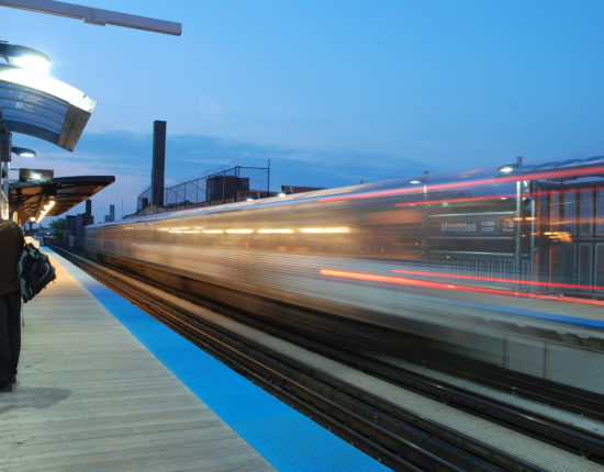 A train rushes past the Montrose CTA brown line in Chicago
